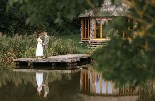 married couple embracing outside The Boat House