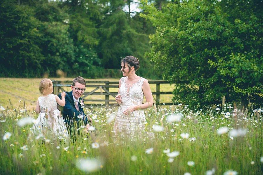 Bride and groom celebrate wedding at Sheepdrove